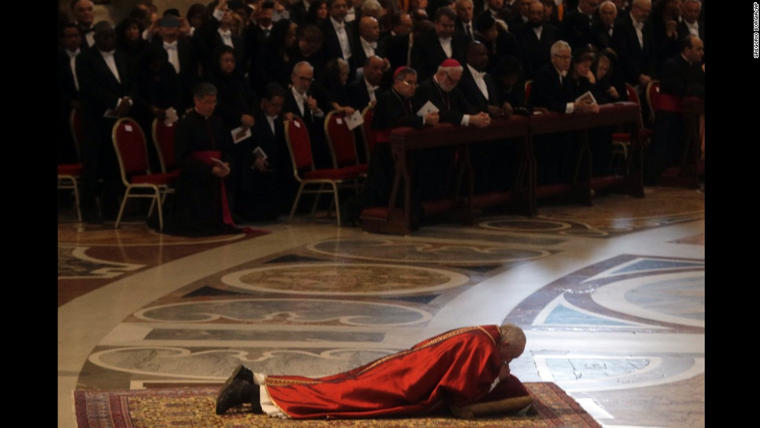 Pope Francis lies down in prayer during the Good Friday Passion of Christ Mass inside St. Peter's Basilica at the Vatican.
