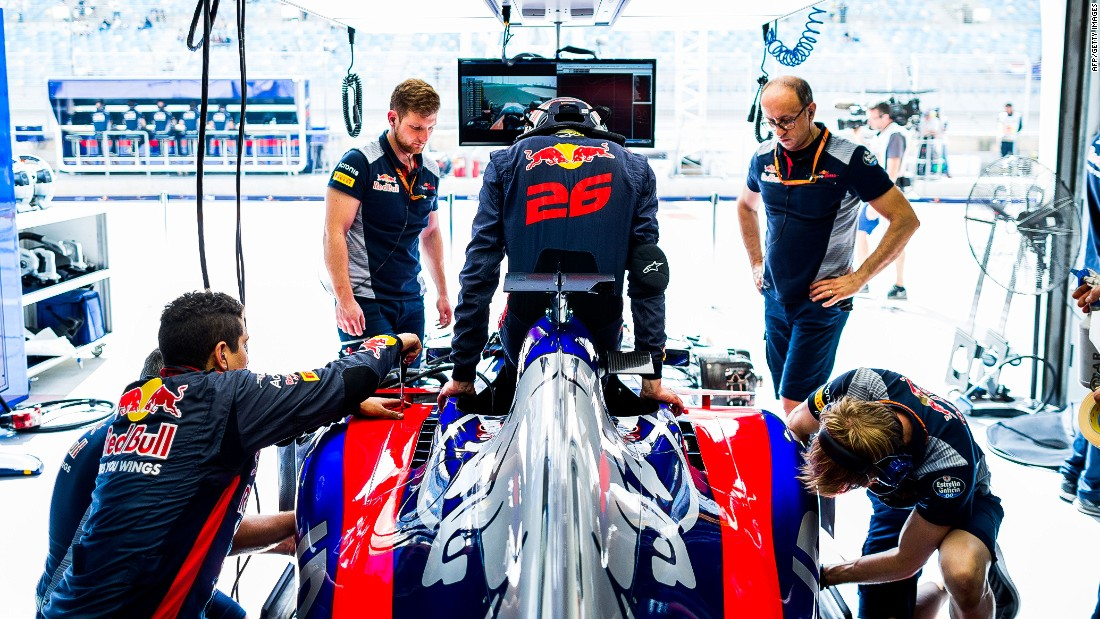 Daniil Kvyat steps into his Toro Rosso car ahead of practice in Bahrain.