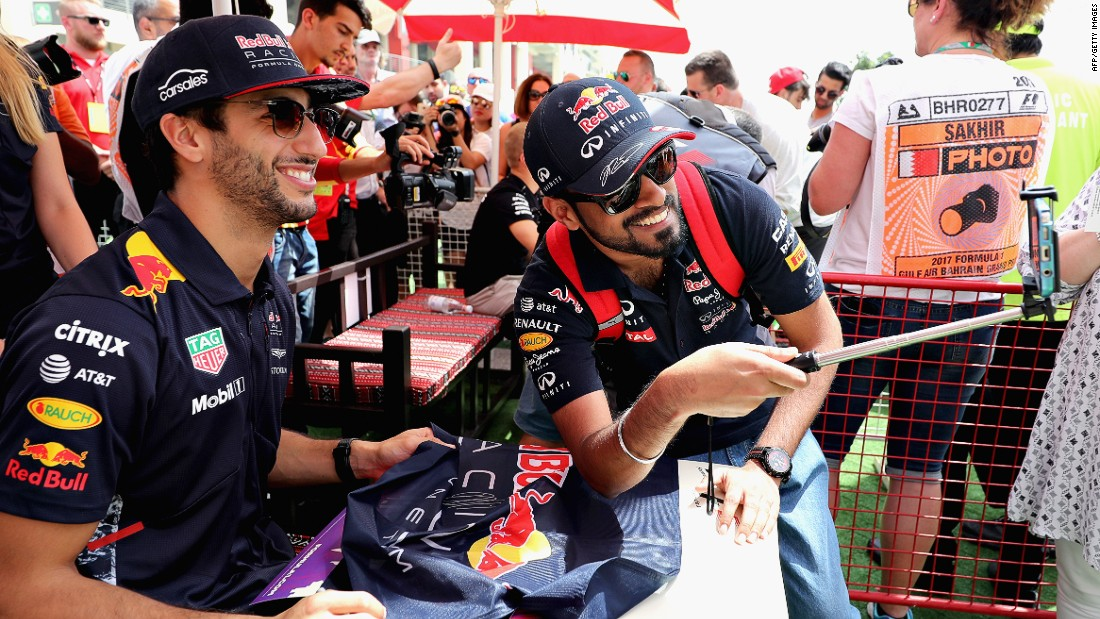 Red Bull Racing's Daniel Ricciardo poses with a fan in Bahrain.