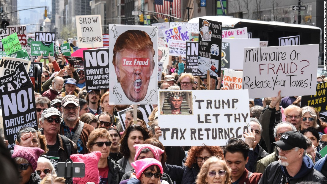 "People participate in a Tax Day protest in New York. Trump has said that Americans ""don't care at all"" about his tax returns, but polls show 74% of Americans say he should release them."