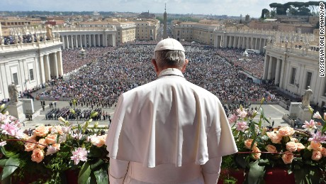"Pope Francis addresses the crowd prior to delivering his Urbi et Orbi message from the main balcony of St. Peter's Basilica, at the Vatican, Sunday, April 16, 2017.  On Christianity's most joyful day, Pope Francis lamented the horrors generated by war and hatred, delivering an Easter Sunday message that also decried the ""latest vile"" attack on civilians in Syria."