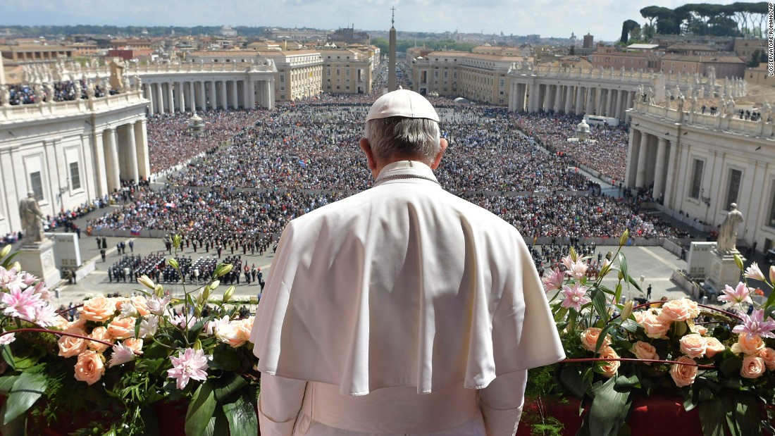Pope Francis addresses the crowd before delivering his Urbi et Orbi message from the main balcony of St. Peter's Basilica at the Vatican on April 16. Across the world Christians are celebrating Easter, commemorating the day followers believe Jesus was resurrected from the dead more than 2,000 years ago.