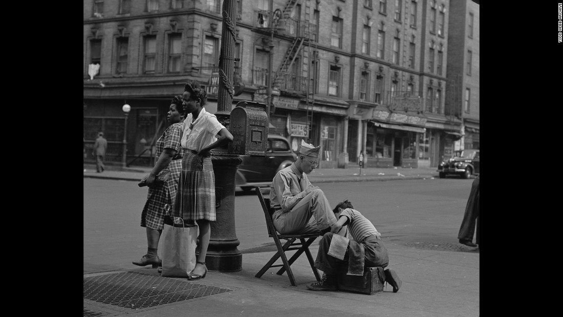 A man on 125th Street gets his shoes shined in this 1946 image. While in New York, Webb became friends with other artists, including Berenice Abbott, Walker Evans, Georgia O'Keeffe, Gordon Parks and Alfred Stieglitz.
