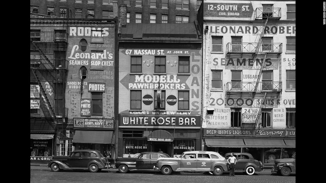 "The White Rose Bar on Sixth Avenue, photographed in 1948. ""From quirky storefronts and horse-drawn carts to characters on the Bowery, Webb brings us a New York that doesn't exist today,"" reads a press release by The Curator Gallery."