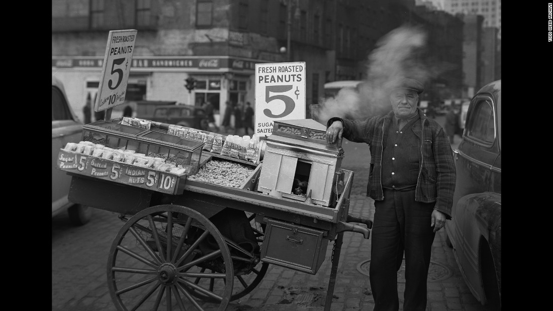 "A peanut vendor at the Battery in 1946. Webb spent several decades photographing all parts of the city, ""from Midtown's skyscrapers to the Lower East Side's tenements, from high-powered businessmen in the Financial District to the remnants of old ethnic enclaves in Lower Manhattan,"" writes the Museum of the City of New York."