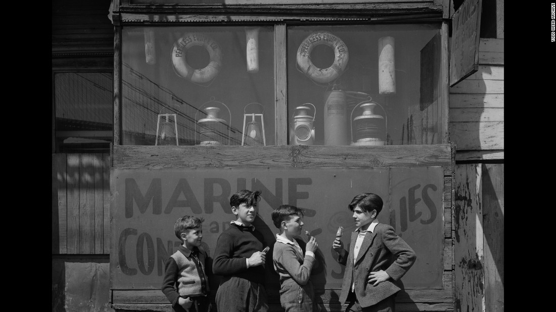 Boys stand near the Fulton Fish Market in 1946.