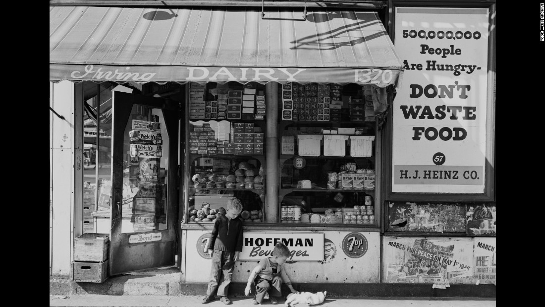 "Children outside a store on Amsterdam Avenue in 1946. ""Armed with a large format camera and tripod, Webb walked around New York engaging with the people and the landscape surrounding him,"" reads a press release from the <a href=""http://www.toddwebbarchive.com/"" target=""_blank"">Todd Webb Archive</a>."