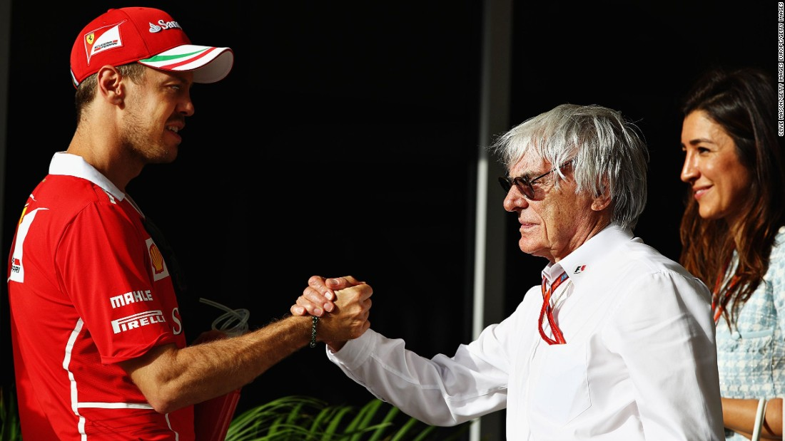 Sebastian Vettel greets former F1 boss Bernie Ecclestone ahead of Sunday's race in Bahrain.