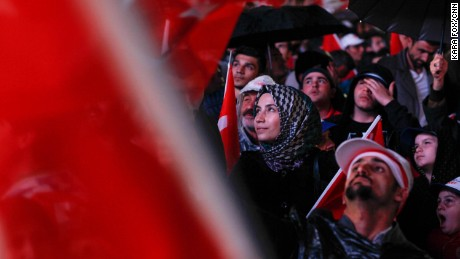 "Turks celebrate at AKP headquarters in Ankara as the early results indicate a win for the ""yes"" ballots."