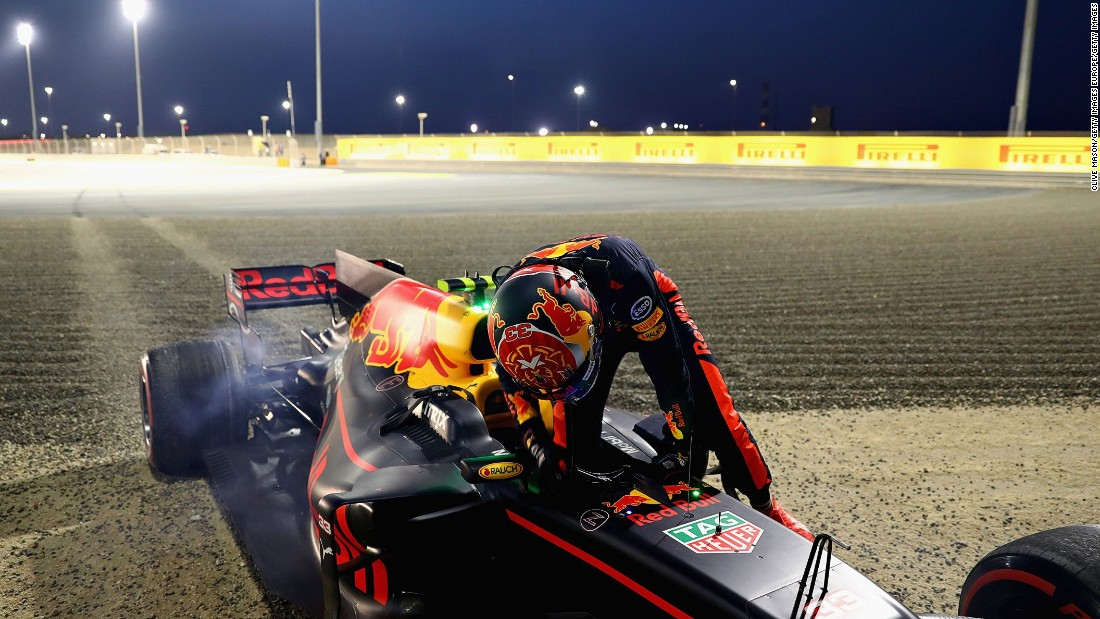 A dejected Max Verstappen steps out of his Red Bull Racing car after suffering brake failure in Sunday's race.