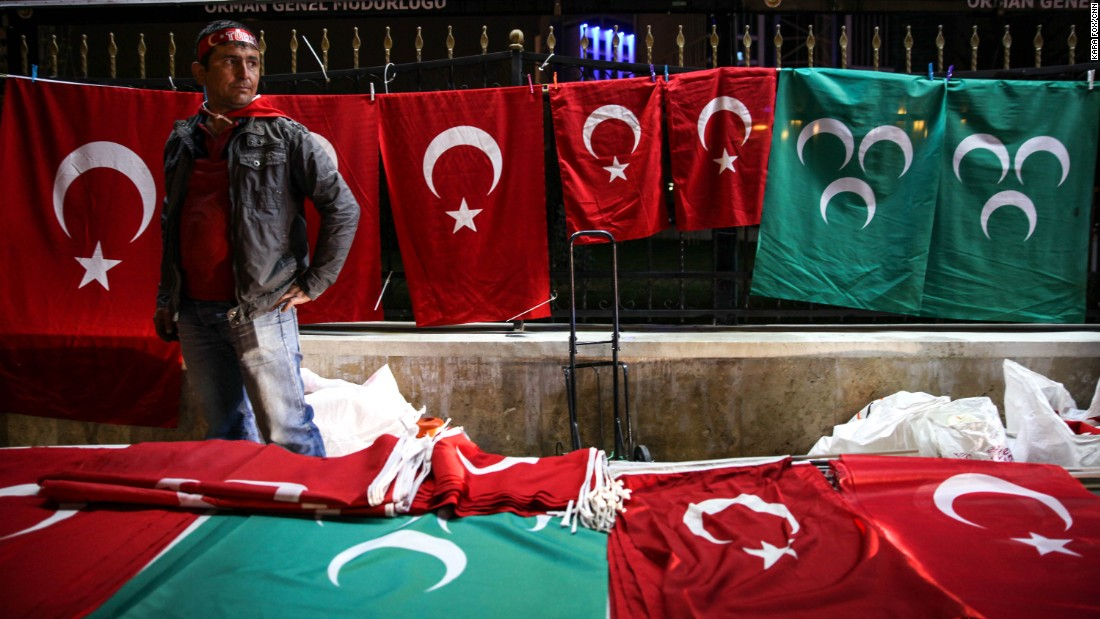 A vendor sells Turkish flag themed items on the night of the referendum result in Ankara.