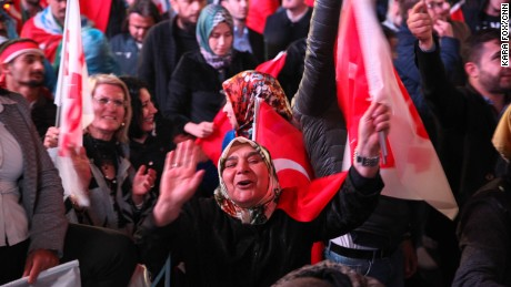 "Erdogan supporters dance to the ""Yes"" campaign song at a pro-Erdogan rally in Ankara on Sunday night."