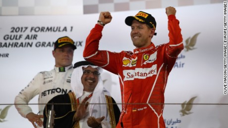 BAHRAIN, BAHRAIN - APRIL 16:  Race winner Sebastian Vettel of Germany and Ferrari celebrates his win on the podium during the Bahrain Formula One Grand Prix at Bahrain International Circuit on April 16, 2017 in Bahrain, Bahrain.  (Photo by Clive Mason/Getty Images)
