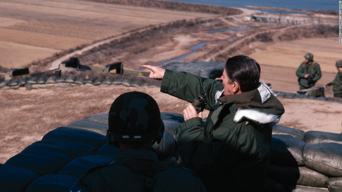 US President Ronald Reagan looks across the DMZ at Guard Post Collier, South Korea, on November 13, 1982.