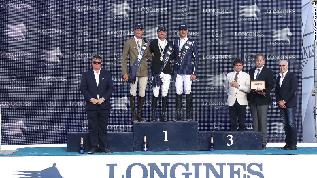 The three top riders (from left to right: Zorzi, Guery and Philippaerts) pose for a shot on the podium following the award ceremony.