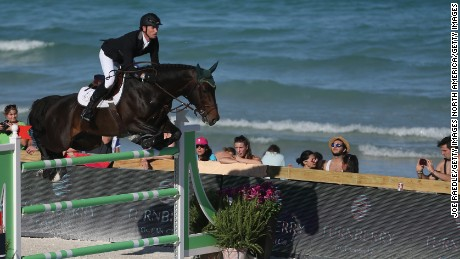 MIAMI BEACH, FL - APRIL 03:  Richie Moloney jumps his horse over a hurdle during the Longines Global Champions Tour stop in Miami Beach on April 3, 2015 in Miami Beach, Florida. The tour, which visits locations around the world, brings together many of the top ranked show jumpers in the world to compete in prestigious locations for prize money.(Photo by Joe Raedle/Getty Images)