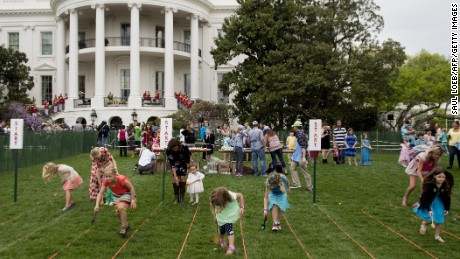 Children participate in an Easter egg roll race during the 139th White House Easter Egg Roll on the South Lawn of the White House in Washington, DC, April 17, 2017.