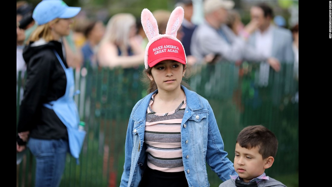 A youngster wears a Make America Great Again hat with bunny ears.
