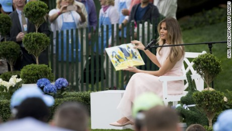 First lady Melania Trump reads to children during the event.