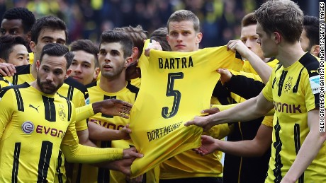 DORTMUND, GERMANY - APRIL 15: Players of Dortmund hold the jersey of their injured team mate Marc Bartra after winning the Bundesliga match between Borussia Dortmund and Eintracht Frankfurt at Signal Iduna Park on April 15, 2017 in Dortmund, Germany.  (Photo by Alex Grimm/Bongarts/Getty Images)