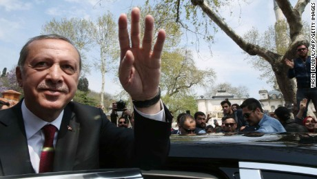 "A handout picture released by Turkish Presidential Press Office on April 17, 2017 shows Turkish President Recep Tayyip Erdogan (L) greeting supporters during his visit to the Eyup Sultan Mosque the day after his victory in a national referendum to change the constitution.  Turkish President Recep Tayyip Erdogan is set to rejoin his ruling Justice and Development Party (AKP) after a key referendum win expanding his powers, a party official said on April 17. / AFP PHOTO / YASIN BULBUL / RESTRICTED TO EDITORIAL USE - MANDATORY CREDIT ""AFP PHOTO / TURKISH PPRESIDENTIAL PRESS OFFICE"" - NO MARKETING NO ADVERTISING CAMPAIGNS - DISTRIBUTED AS A SERVICE TO CLIENTSYASIN BULBUL/AFP/Getty Images"