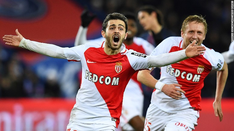 Monaco's Portuguese midfielder Bernardo Silva (C) celebrates after scoring a goal during the French L1 football match between Paris Saint-Germain and Monaco at the Parc des Princes stadium in Paris on January 29, 2017.  / AFP / FRANCK FIFE        (Photo credit should read FRANCK FIFE/AFP/Getty Images)