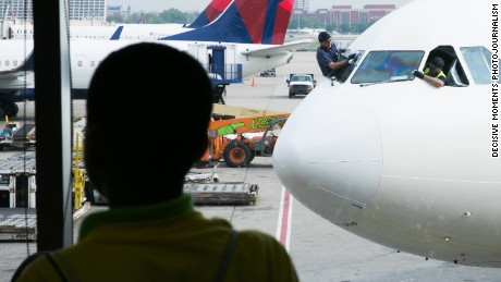 "Daniel Williams, 10, watches planes at April's ""Wings for Autism"" event at Hartsfield-Jackson Atlanta International Airport."