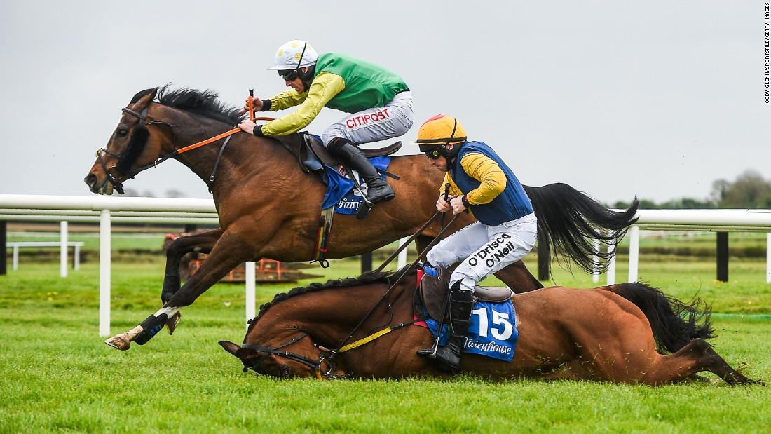 Jockeys Davy Russell and Sean Flanagan race in the Fairyhouse Easter Festival in Meath, Ireland, on Sunday, April 16. Flanagan and his horse, Runforbob, fell during this maiden hurdle.