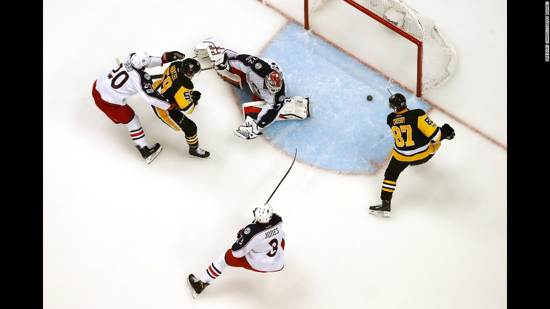 Sidney Crosby of Pittsburgh scores a goal past Columbus' Sergei Bobrovsky during an NHL Stanley Cup playoff game in Pittsburgh on Friday, April 14. Pittsburgh won 4-1.