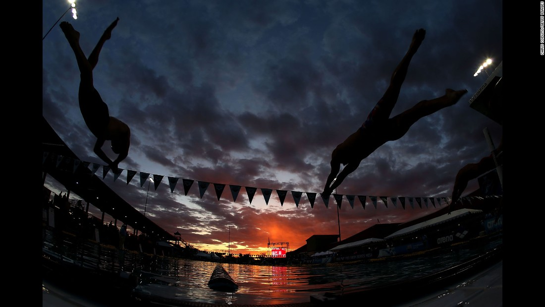 Trevor Carroll, left, and Kyler Van Swol compete in the 100-meter freestyle head C final in Mesa, Arizona, on Sunday, April 16.