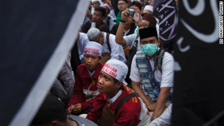 "JAKARTA, INDONESIA - MARCH 31: Thousands of Indonesian Muslims protest against the Jakarta governor Basuki Tjahaja Purnama known widely as ""Ahok"" on March 31, 2017 in Jakarta, Indonesia.   The leader of one of the groups behind this protest and recent others was arrested Friday morning on suspicion of treason, as religious and political sentiments are increasingly contentious ahead of the Jakarta Governor election in April.(Photo by Ed Wray/Getty Images)"