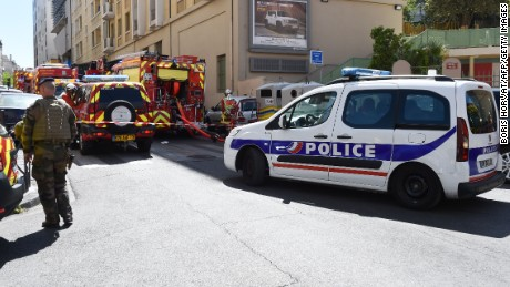 A French soldier, police and firefighters vehicles are seen at the site of a police search at the home of one of the two men arrested, as they were suspected of preparing an attack just days ahead of the first round of France's presidential vote on April 18, 2017 in the third district of Marseille. The suspects, aged 23 and 29, were taken into custody by French domestic intelligence service agents in the southern city of Marseille, a source close to the probe said.