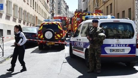French security service at the site of a police search at the home of one of two men arrested on suspicion of preparing an attack just days ahead of the first round of France's presidential vote.