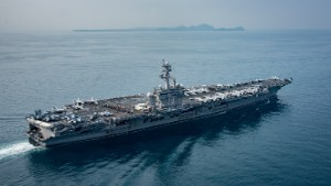 170415-N-BL637-044 SUNDA STRAIT (April 15, 2017) The aircraft carrier USS Carl Vinson (CVN 70) transits the Sunda Strait. The Carl Vinson Carrier Strike Group is on a scheduled western Pacific deployment as part of the U.S. Pacific Fleet-led initiative to extend the command and control functions of U.S. 3rd Fleet. U.S Navy aircraft carrier strike groups have patrolled the Indo-Asia-Pacific regularly and routinely for more than 70 years. (U.S. Navy photo by Mass Communication Specialist 2nd Class Sean M. Castellano/Released)