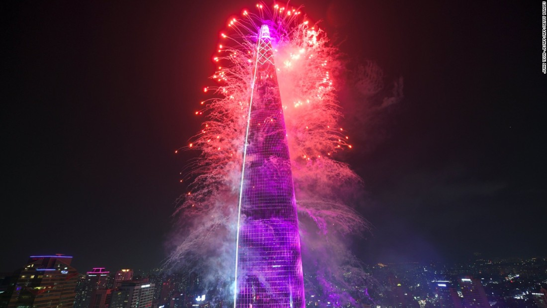 Fireworks celebrate the opening of Lotte World Tower in Seoul on April 2, 2017.