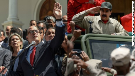 "Venezuelan President Nicolas Maduro salutes as he arrives for the celebrations for the seventh anniversary of the Bolivarian Militia in Caracas on April 17, 2017. Venezuela's defence minister on Monday declared the army's loyalty to Maduro, who ordered troops into the streets ahead of a major protest by opponents trying to oust him. Venezuela is bracing for what Maduro's opponents vow will be the ""mother of all protests"" Wednesday, after two weeks of violent demos against moves by the leftist leader and his allies to tighten their grip on power.  / AFP PHOTO / Federico PARRA        (Photo credit should read FEDERICO PARRA/AFP/Getty Images)"