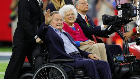President George H.W. Bush and Barbara Bush arrive for the coin toss prior to Super Bowl 51 between the Atlanta Falcons and the New England Patriots at NRG Stadium on February 5, 2017 in Houston, Texas.