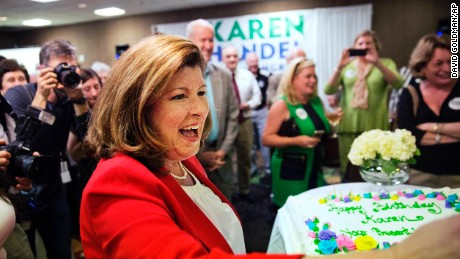Republican candidate for Georgia's Sixth Congressional seat Karen Handel thanks supporters after being presented with a cake as her birthday is celebrated at an election night watch party in Roswell, Ga., Tuesday, April 18, 2017. Republicans are bidding to prevent a major upset in a conservative Georgia congressional district Tuesday where Democrats stoked by opposition to President Donald Trump have rallied behind a candidate who has raised a shocking amount of money for a special election.