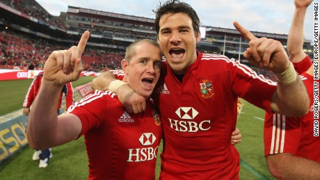 JOHANNESBURG, SOUTH AFRICA - JULY 04: Shane Williams (L) celebrates with team mate Mike Phillips after their victory in the Third Test match between South African and the British and Irish Lions at Ellis Park Stadium on July 4, 2009 in Johannesburg, South Africa.  (Photo by David Rogers/Getty Images)