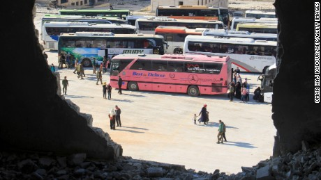 Syrians from the government-held towns of Fuaa and Kafraya, which have been under crippling siege for more than two years, reach with buses the edge of the rebel-held transit point of Rashidin outside government-held second city Aleppo, on April 19, 2017. The evacuation of civilians and fighters from besieged Syrian towns resumed after a weekend bombing at a transit point killed 126 people, 68 of them children, an AFP correspondent reported. / AFP PHOTO / Omar haj kadourOMAR HAJ KADOUR/AFP/Getty Images