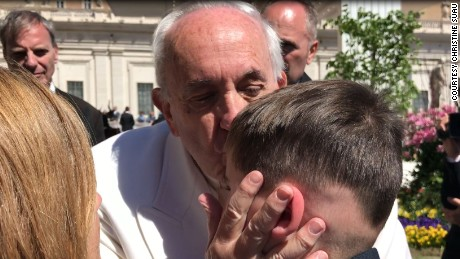 Pope Francis blesses Devin during a brief encounter in Vatican City.