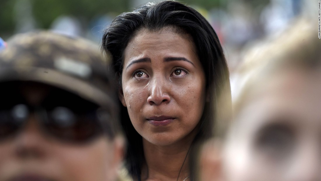 A demonstrator reacts during a march on Saturday, April 15, against Venezuelan President Nicolas Maduro's government. Several people have been killed and many more injured during recent protests and a subsequent crackdown on government opponents.
