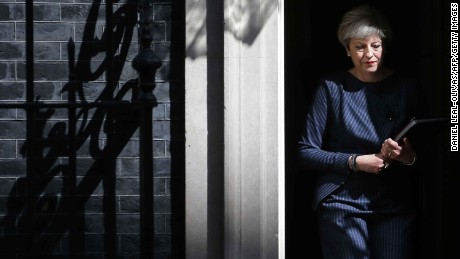 TOPSHOT - British Prime Minister Theresa May walks out of 10 Downing Street to speak to media in central London on April 18, 2017.