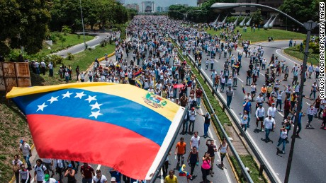 Thousands of people rally against Venezuelan President Nicolas Maduro along the Francisco Fajardo highway in eastern Caracas.