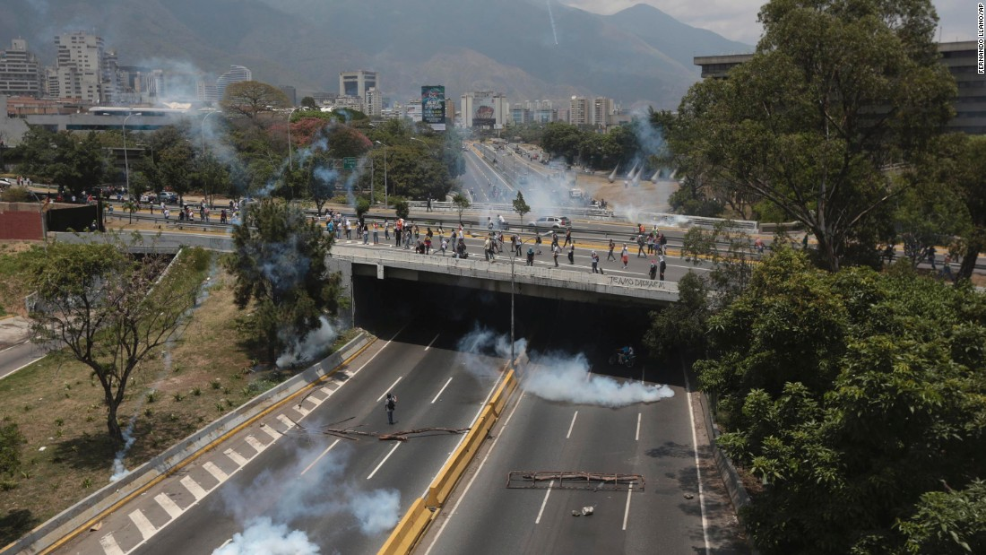 Clouds of tear gas spread across a highway in Caracas, Venezuela, during clashes on Monday, April 10, between demonstrators and the Bolivarian National Guard. Demonstrators demanded new elections and vowed to stay on the streets during the traditionally peaceful Easter Week.