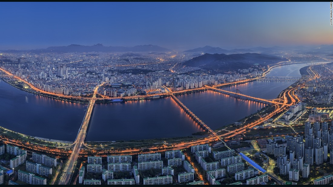 The expansive view overlooks the Seoul cityscape and Cheonggyecheon River, which flows through the heart of the city.