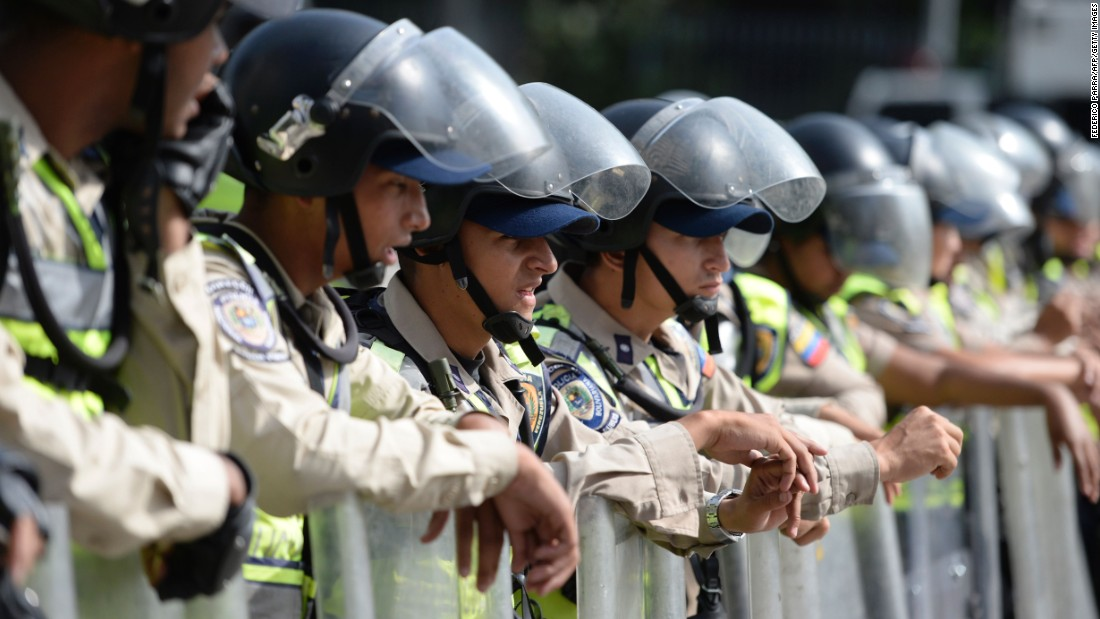 Riot police are deployed on April 19.