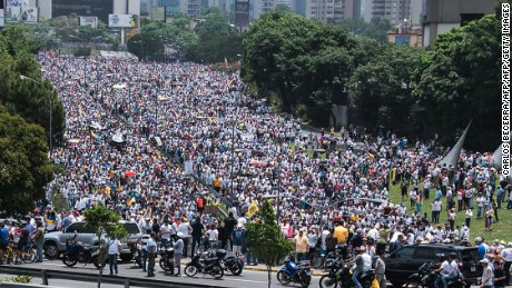 View of a mass march against Venezuelan President Nicolas Maduro, in Caracas on April 19, 2017.  Venezuelans took to the streets Wednesday for massive demonstrations for and against President Nicolas Maduro, whose push to tighten his grip on power has triggered deadly unrest that has escalated the country's political and economic crisis. / AFP PHOTO / CARLOS BECERRA        (Photo credit should read CARLOS BECERRA/AFP/Getty Images)