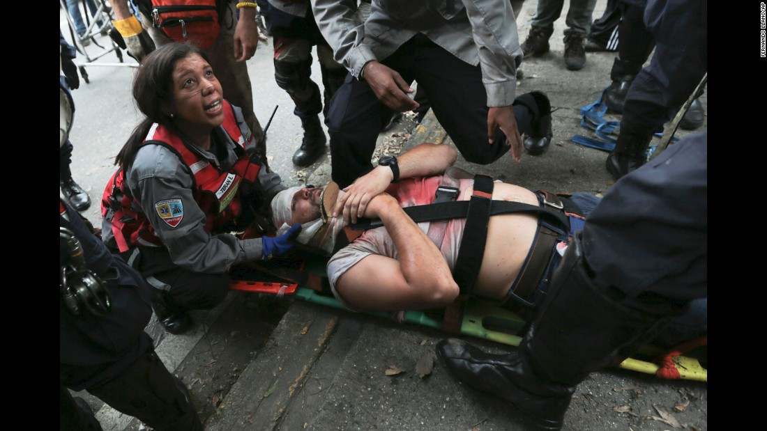 Rescue workers tend to a demonstrator hit by a tear gas canister during the anti-government protests.