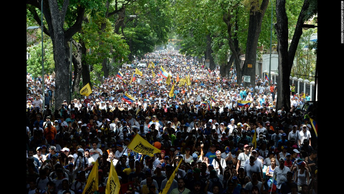 Thousands of demonstrators take to the streets of Caracas to rally against President Nicolas Maduro on April 19.